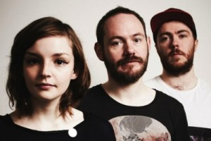 CHVRCHES, with Mayberry  to the far left.