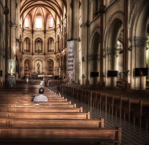 man-praying-in-church